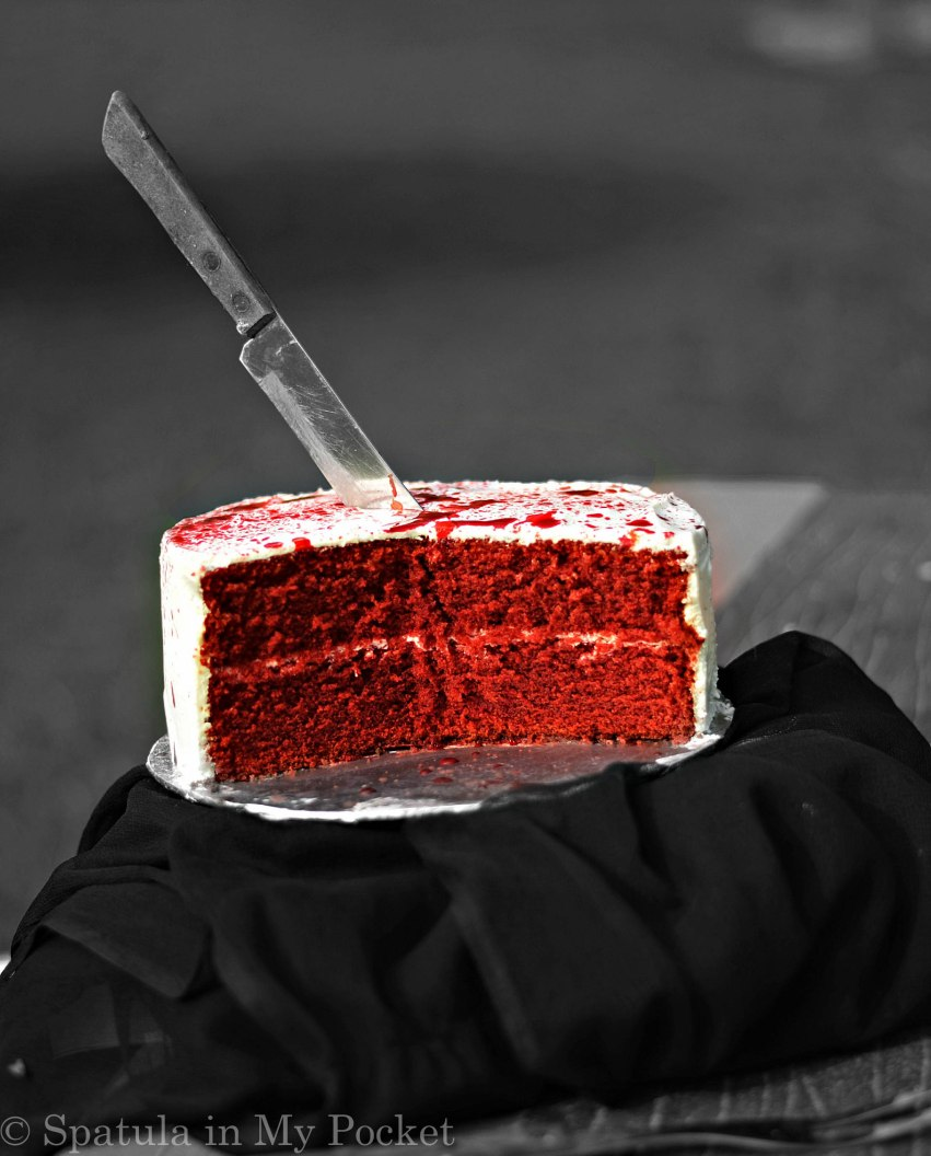 This blood splattered Red Velvet cake will make for a perfect center piece for your Halloween party, and will have everyone's taste buds quivering!