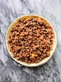 Peach Crumble Pie. A flaky crust filled with juicy peaches and topped with a walnut cinnamon crumble. It's sweet. It's juicy. It's delicious.