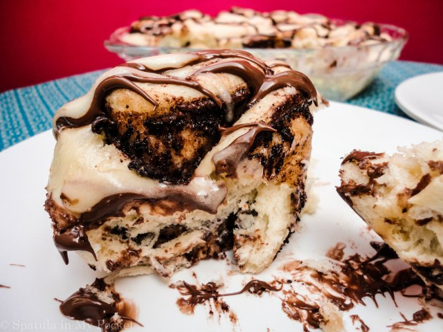 This light fluffy dough, is filled with Nutella and butter and cinnamon, then baked until gooey and brown, and topped with drizzles upon drizzles of cream cheese glaze and more molten Nutella.