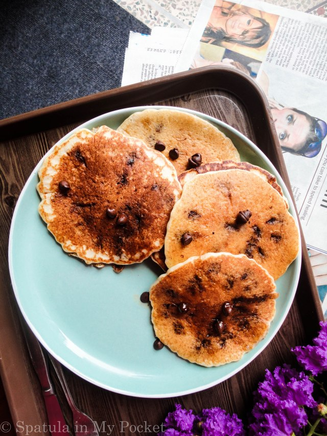 The ultimate recipe for the ultimate stack of pancakes, sweetened with bananas, and loaded with melty gooey chocolate chips. #banana #chocolatechip #pancakes
