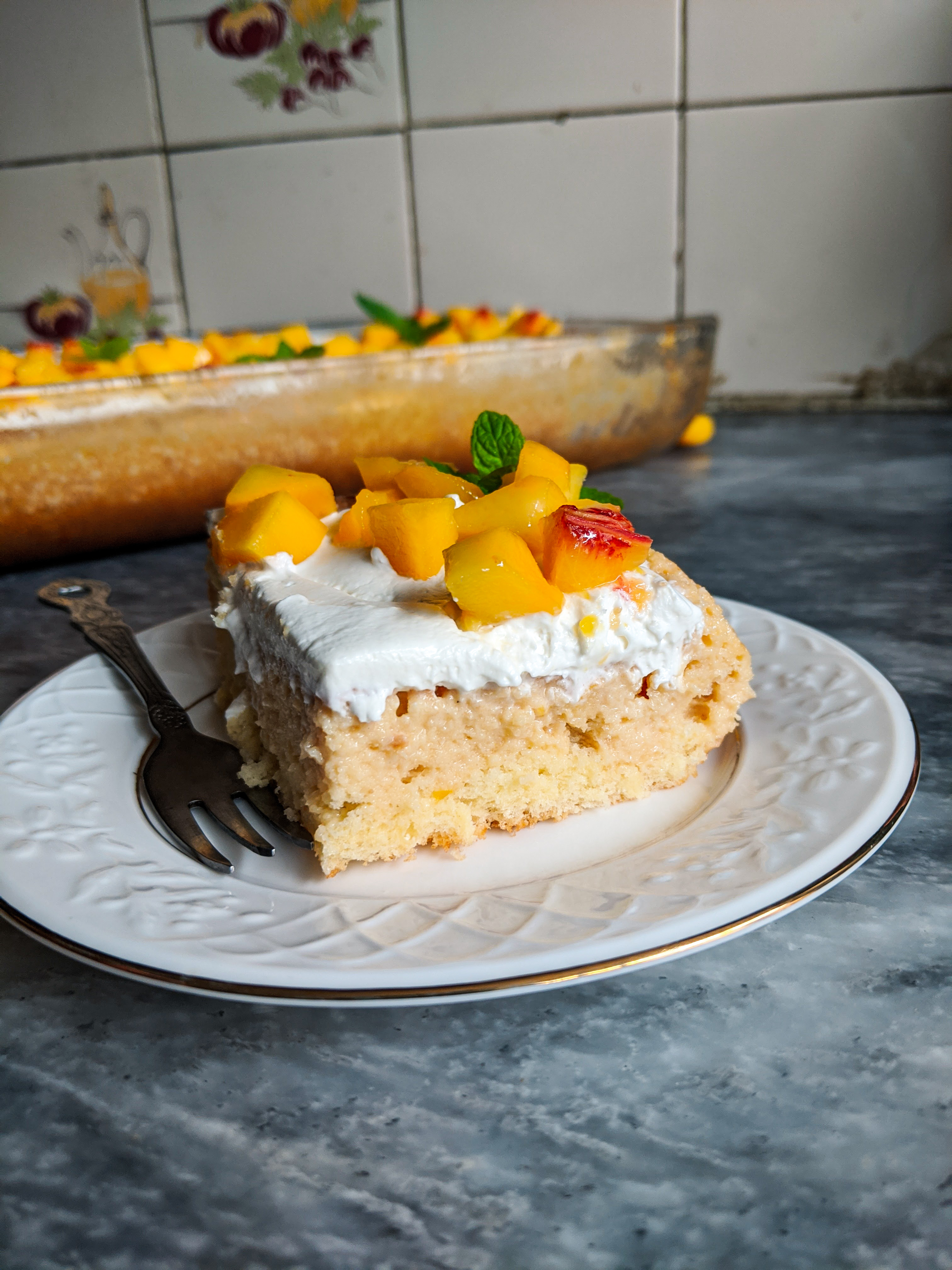 Tres leches cake. A light and fluffy cake that is soaked with three milks and chilled until it is perfectly moist.